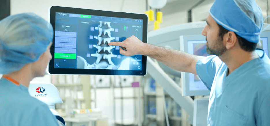 Surgeons Viewing Spine on Screen
